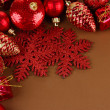 Beautiful Christmas decorations on brown background — Stock Photo