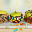 Stock Photo: Candied apples on sticks on bright background