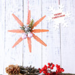 Christmas composition with snowflakes on wooden background — Stock Photo #37557009