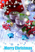 Wine glasses and Christmas decorations on wooden background — Stock Photo