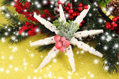 Beautiful snowflake with fir branch on yellow background — Stock Photo