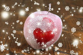 Holiday apple with frosted heart on wooden background — Foto de Stock