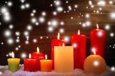 Burning candles on wooden background — Stock Photo
