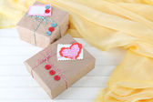 Paper gift boxes on wooden background — Zdjęcie stockowe