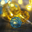 Christmas decorative balls and garland, on wooden background — Stock Photo #37598809