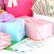 Gift boxes with money close up — Stock Photo