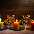 Burning candles and Christmas decorations on wooden background — ストック写真