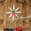 Christmas composition with snowflakes on wooden background — Stock Photo #37599365