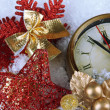 Clock and Christmas decorations under snow close up — Stock Photo #37611071