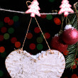 Blank heart and Christmas accessories on black background with lights — Stock Photo #37611131