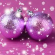 Christmas balls on purple background — Stock Photo