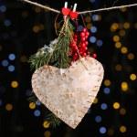 Decorative heart on rope on shiny background — Stok fotoğraf