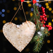 Decorative heart on rope on shiny background — Photo