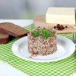 Stock Photo: Buckwheat in plate with bread and butter closeup