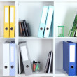White office shelves with folders and different stationery, close up — Stock Photo #37615647