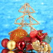 Composition of Christmas balls on blue background — Stock Photo #37615711