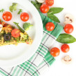 Slice of tasty vegetarian pizza and vegetables on plate, isolated on white — Stok fotoğraf