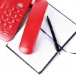 Telephone and notepad and other items, isolated on white — Stock Photo