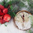 Stock Photo: Clock with fir branches and Christmas decoration under snow close up