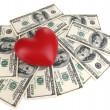 Stock Photo: Love and money concept. Heart and Americcurrency isolated on white