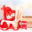 Romantic still life with heart in wooden casket — Stock Photo #37617687