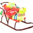 Sledge with Christmas presents, isolated on white — Stock Photo