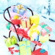 Sledge with Christmas presents, on winter background — Stock Photo #37617705