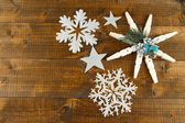 Beautiful snowflakes on wooden background — Stock Photo