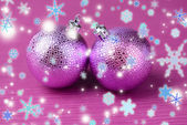 Christmas balls on purple background — Stock Photo