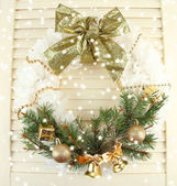Christmas wreath on wooden background — Stock Photo