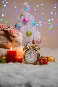 Composition with plaids, candles and Christmas decorations, on white carpet on bright background — Stockfoto
