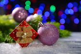 Christmas decorations on wooden table, on bright background — Photo