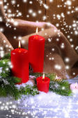 Candles and Christmas decoration on wooden background — Stockfoto