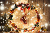 Beautiful Christmas wreath, on wooden background — Photo