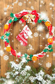 Beautiful Christmas wreath, on wooden background — Stockfoto