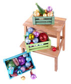 Boxes with Christmas decorations on small ladder, isolated on white — Stock Photo