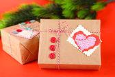 Papper gåva lådor på färgbakgrund — Stockfoto