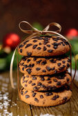 Delicious Christmas cookies in jar on table on brown background — Stock Photo