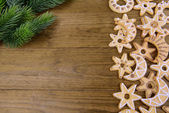 Delicious Christmas cookies on wooden background — Foto Stock