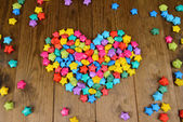 Paper stars with dreams on wooden background — Stock Photo