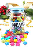 Paper stars with dreams in jar on white background — Stock Photo