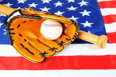 Baseball glove, bat and ball on American flag background — Stock Photo