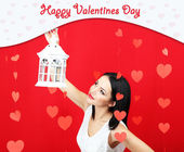 Attractive young woman with lantern on Valentine Day — Stock Photo