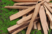Stack of firewood on grass close up — Stock Photo