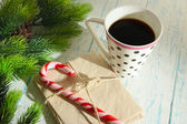 Christmas candy canes, cup with hot drink and letters for Santa, on wooden background — ストック写真