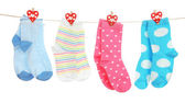 Socks hanging on clothesline isolated on white — Stock Photo