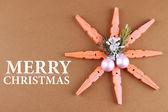 Beautiful snowflake on brown background — Stock Photo