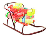 Sledge with Christmas presents, isolated on white — 图库照片