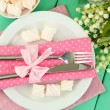 Table setting in white and pink tones on color wooden background — Stock Photo #37620911