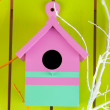 Decorative nesting box with color branches, on color wooden background — Stock Photo #37620963